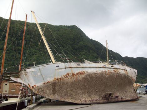 Family living underneath this stranded yacht.