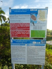 information board on beach at La surprise