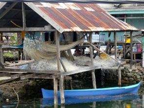 Mending the fishing nets at Sampela Village