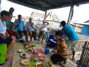 Our hosts Pondang and wife Ruis offering us lunch