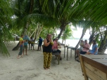 Enjoying fresh coconut milk at Pasir Panjang at Ngurbloat Beach