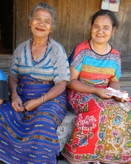 Bena women (red mouth due to chewing betel nut)