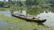 Canoe full of bricks